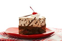 Chocolate cake on red dish Royalty Free Stock Image