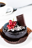 Сhocolate cake with redcurrants close up Stock Photography