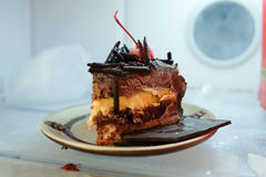 Chocolate cake in refrigerator stock images