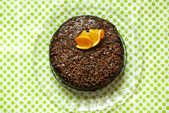 Chocolate cake rich with ganache and orange peel, top shot Royalty Free Stock Images