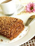 Chocolate Cake Roll And Cup Of Tea Stock Image