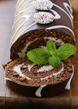Chocolate cake  roll with vanilla cream Stock Photos