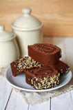 Chocolate cake-roll on a white saucer Stock Image