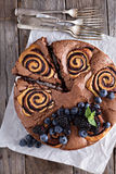 Chocolate cake with rolls inside Stock Images