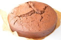 Chocolate cake. Round, cracked chocolate cake on white background Royalty Free Stock Photo