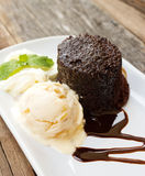 Chocolate cake with rum raisin ice cream and whipping cream on w Stock Photo