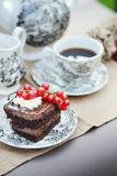 Chocolate cake served with a cup of coffee Stock Image