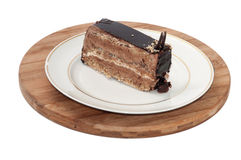 Chocolate cake served on the white plate Royalty Free Stock Photos