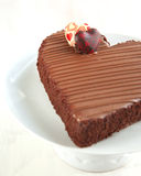 Chocolate cake in the shape of a heart. Royalty Free Stock Photos