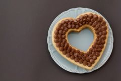 Chocolate cake in shape of heart on Valentine`s Day or Woman`s day. Place for text.  royalty free stock photography