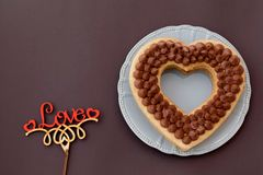 Chocolate cake in shape of heart on Valentine`s Day or Woman`s day. Place for text.  stock image