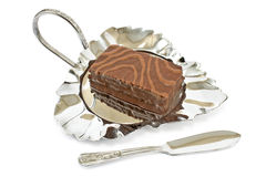 Chocolate cake on silver plate Royalty Free Stock Image