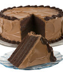 Chocolate Cake with slice. A chocolate cake with a slice cut royalty free stock photo