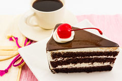 Chocolate cake slice and coffee cup. Stock Images