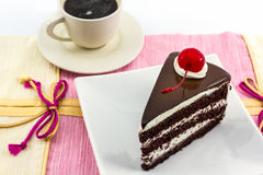Chocolate cake slice and coffee cup. Stock Image