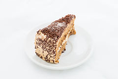 Chocolate cake slice with curl on white dish Royalty Free Stock Photos