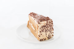 Chocolate cake slice with curl on white dish Stock Images