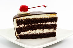 Chocolate cake slice with red cherry fruit. Stock Photography