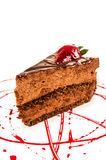 Chocolate cake slice with red sauce Royalty Free Stock Photography