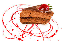 Chocolate cake slice with red sauce Stock Photography