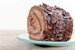 Chocolate cake. Slice on a transparent plate Royalty Free Stock Image