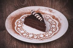 Chocolate cake slice on white plate Stock Photo