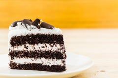 Chocolate cake slice. Chocolate cake slice on the white plates royalty free stock photography