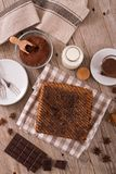 Chocolate cake. Chocolate cake with spices on wooden table royalty free stock photography