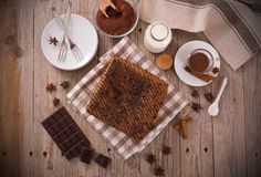 Chocolate cake. Chocolate cake with spices on wooden table stock photos