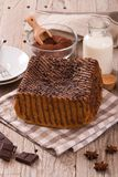 Chocolate cake. Chocolate cake with spices on wooden table royalty free stock image