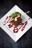 Chocolate cake. On a square plate taken from above Royalty Free Stock Image