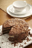 Chocolate cake still life with coffee or tea cup Stock Photos