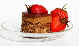 Chocolate cake with strawberries. Chocolate cake with fresh strawberries on a plate Stock Photography