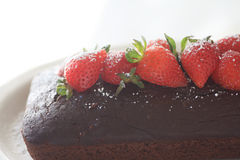 Chocolate cake and strawberries with copy space Royalty Free Stock Images