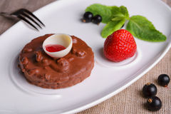 Chocolate cake with strawberries and currants royalty free stock photos