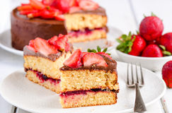 Chocolate cake with strawberries. Chocolate cake with ganache and strawberries royalty free stock photos