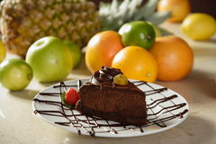 Chocolate cake and strawberry. And fruit on a background Royalty Free Stock Images