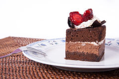 Chocolate cake with strawberry and fork. Chocolate Cake in plate with strawberry Stock Image