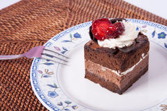 Chocolate cake with strawberry and fork. Chocolate Cake in plate with strawberry Stock Images