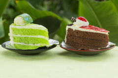 Chocolate cake with strawberry jam and Pandan cake Royalty Free Stock Image