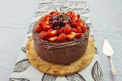 Chocolate cake with strawberry and merry Royalty Free Stock Photos