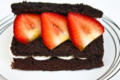 Chocolate cake with strawberry on top Stock Photo