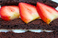 Chocolate cake with strawberry on top Stock Images