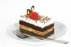 Chocolate cake with strawberry on top. Piece of chocolate cake with strawberry decorate on top stock photos