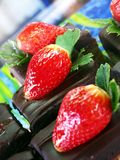 Chocolate cake with strawberry on top. Yummy chocolate cake with fresh strawberry on top Stock Photography