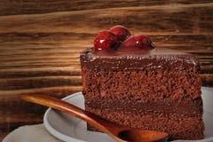 Chocolate cake. Sweet Chocolate cake with cherry Stock Photo