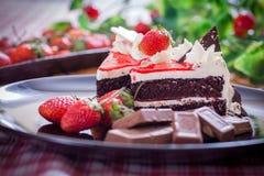 Chocolate cake. Sweet chocolate cake with strawberry royalty free stock photo