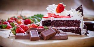 Chocolate cake. Sweet chocolate cake with strawberrys royalty free stock image