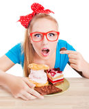 Chocolate and cake sweets temptation. Funny woman is  eating dessert Royalty Free Stock Photography