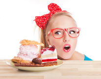 Chocolate and cake sweets temptation. Funny woman about to eat a dessert Royalty Free Stock Image